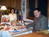 Chrissi and Niko relaxing with books and artwork